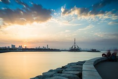 Kuwait - Marina Waves (Yousef Bohamed) Tags: sunset sky cloud beach rock clouds marina sunrise landscape photography big nikon colorful long exposure waves gulf state cloudy east arab lee kuwait arabian middle density salmiya stopper d800 neutral 1635 yousef   of     bohamed