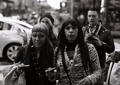 Times Square NYC film (astoria4u) Tags: street new york city nyc bw white black film portraits 35mm square 50mm candid fil scene tourist times manhatten f12 passersby
