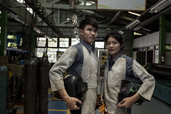 Man and Lady workers (djmThailand) Tags: worker man woman welding work factory industrial oil automotive stone two steel grinder welder machinery tool pipeline engineering line refinery light glove technology equipment protection gas cutting abrasive production automation construction laser manufacture metal surface spark welded iron fabrication tech grinding robotic workshop safety manufacturing plant machine robot metalworking workplace industry ladyworker
