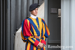 Rome, Italy- A Swiss Guard standing at the entrance of (New) St. Peter's Basilica located in Vatican City (an enclave of Rome). Begun by Pope Julius II, St. Peter's is dedicated to the Apostle Peter and is built in the form of a Latin cross filled with Re (Remsberg Photos) Tags: europe italy rome ancient ancientcivilization roman architecture buitstructure tourist sightseeing photography history historical internationallandmark capitolcity romaprovince ancientrome art church religion basilica stpetersbasilica newstpetersbasilica vaticancity pope popejuliusii apostle pilgrimage michelangelo peter renaissance baroque swissguard guard ita