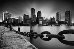 Boston Skyline (Geoffrey Gilson) Tags: boston skyline architecture cityscape long exposure black white fan pier chains clouds