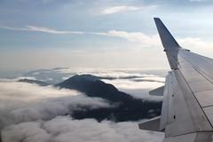 Flying into Cairns (Jade Higman) Tags: travel sky mountains clouds plane canon landscape rainforest flight wing australia aeroplane cairns vast ttot lphills