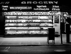 24 Hour Grocery (minnepixel) Tags: street city nyc newyorkcity flowers summer urban blackandwhite bw plants les fruit night canon dark photography store downtown lowereastside nighttime hour bodega 24 gothamist grocery gotham fruitstand atm emptiness cornerstore 24hours g11 canonpowershotg11