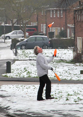 It's Never Too Cold for Juggling (ƒliçkrwåy) Tags: road street winter snow juggling juggler guildford performer residential unexpected hivis
