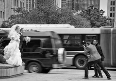 Bride and Groom Jump (Richard Pilon) Tags: street wedding blackandwhite bw chicago blackwhite jump nikon candid streetphotography brideandgroom blackandwhitephotography d90 nikond90