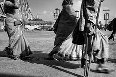 Walking Ahead (Satyaki Basu) Tags: street people india canon eos indian crutches kolkata bengal bnw calcutta handicapped westbengal 1755 howrah 450d gettyimagesmiddleeast