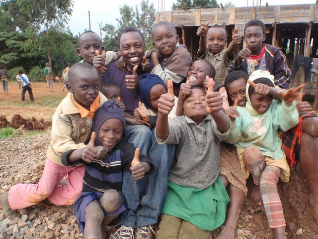 Moving Mountains Kenya Chairman Gilbert Njeru with kids from Gatwe Primary School, on the lower slopes of Mt Kenya