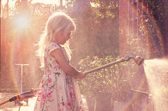 Dreaming of summer - Explore (Sunshine-D) Tags: light summer sun girl backlight garden gardening spray hose sunflare hosepipe
