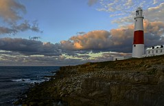 Portland Bill (dorrisd) Tags: morning light sea england sky lighthouse tower clouds sunrise buildings portland faro coast bill travels rocks wolken zee cliffs dorset gb coastline rough farol navigation leuchtturm fiery engeland zonsopgang reizen portlandstone portlandbill promontory kust rotsen viti kustlijn baken vuurtorens canon18135mm canoneos5od phrare