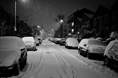 Haggerston Snowy Nights (Sven Loach) Tags: road street uk trees winter england bw snow cars night lights evening nikon mood britain falling explore covered blanket hackney neighbourhood e8 reportage eastlondon shrubland haggerston d5100
