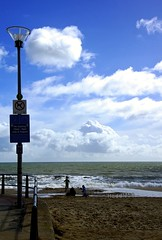 ShorePlay (Hodd1350) Tags: sky people signs beach clouds sand waves sony lamppost shore dorset railings sandbanks poole footprintsinthesand a77