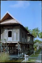 Terrapuri Heritage Village. . . (Hafiz_Markzzaki) Tags: trees classic buildings bluesky 35mmfilm malaysia villas terengganu kodakgold200 helios103 setiu penarik kiev4m classichouse terrapuriheritagevillage kampungmangkuk 53mmf18 anarchitectureofalostkingdom terengganumalayclassichouse