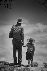 Father and Son (robertdownie) Tags: sky portrait hands clouds cloudscape rock black white son cowboy father hats holding australia queensland fnq