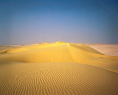 The Southern Dune Vista (Doha Sam) Tags: 100 4x5 analogue chrome crowngraphic desert dunes e6 epsonv700 film fuji largeformat linearscan manualfocus pacemakercrowngraphic piccure positive qatar rawtherapee samagnew sand scan southerndesert summer velvia wilderness iso100 smashandgrabphotocom wwwsamagnewcom