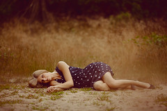 Down But Good Hair Day (CARECOM photography) Tags: down lying woman dress outdoor sand floor long hair sad sadness sensual