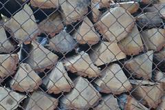 005 (dena429) Tags: pasadenamaryland annearundelcounty stacked oak firewood chain link fence splitwood earthtonecolors brown tan rust pattern fuel