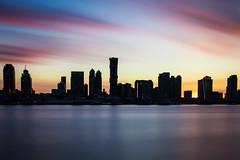Across the Hudson II (pmobiled) Tags: sunset dusk skyline sky clouds jerseycity newjersey city longexposure hudsonriver river water reflections