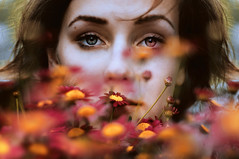 seconds seen in summer (laura zalenga) Tags: pink flowers red summer woman brown plant nature girl face yellow self hair eyes gesicht close wind sommer balcony pale stare blume gaze auge mdchen bunt direct frhling laurazalenga