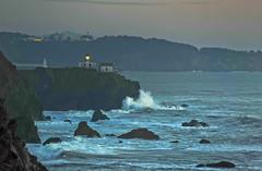 this way out (pbo31) Tags: california blue sunset lighthouse color nature northerncalifornia outdoors coast nikon waves earth tide january cliffs pacificocean shore bayarea marincounty westcoast northbay pointbonita 2013 fortbarry d700 goldengatenatonalrecreationarea