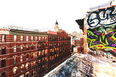 Downtown rooftop expositions. (Jperture) Tags: nyc newyork brick rooftop canon vintage buildings graffiti noho manhattan wideangle 1740f4l eos5d northhouston