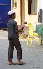 young boy practising his spin ball (alison ryde - back in town for now) Tags: life xmas travel people holiday colour canon living asia visit east explore characters local srilanka 2012 southernhemisphere cricketer srilankans gallefort