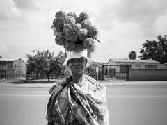 brooms on her head // mamelodi, south africa (pamela ross) Tags: life street woman lady pen southafrica head streetphotography olympus carry brooms mamelodi pamelaross epl5