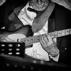 In the Mood - Guitar (lynn.h.armstrong) Tags: birthday camera city party bw musician music white ontario canada man black art monochrome lens geotagged photography photo hands aperture nikon long flickr cornwall guitar south wb images player lynn suit h instrument getty strings nikkor armstrong stormont limits sault frets ingleside twitter tumblr d7000 lynnharmstrong