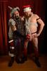 Tinsel Men (naturalturn) Tags: california santa party shirtless portrait usa man men hat oakland costume couple metallic santaclaus image:rating=5 image:id=138170