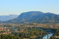 Town of Luang Prabang Laos in Afternoon Light (UNESCO World Heritage Site) (Maria_Globetrotter) Tags: world city panorama mountain heritage tourism canon de point landscape la site asia republic village view si hill over january unesco peoples backpacking di southeast mundial laos wat picturesque lao democratic province cultural overview luang weltkulturerbe whs prabang mondial patrimoine landskap humanidad patrimonio chom  mountainous welterbe 2011  louangphrabang lhumanit th 550d 1585 gii werelderfgoed sn vrldsarv verdensarven  sathalanalat paxathipatai paxaxon  mariaglobetrotter wderbe