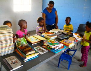 Children looking at books that have arrived