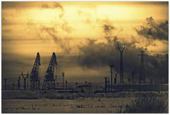 Cranes and Power Lines (Jyrki Salmi) Tags: winter sky snow clouds dark fire nikon power harbour crane line cranes jyrki kotka d600 salmi hietanen mygearandme