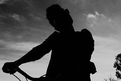 Many Shades of Black (Irene Stylianou) Tags: portrait blackandwhite bw woman nature bike bicycle silhouette outdoors nikon song cyprus portraiture nikkor dslr nikondigital nicosia 3570mm nikoncamera womanonbicycle blackandwhiteportrait nikkor3570mm digitalblackandwhite nikondslr womanportrait d80 theraconteurs nikond80 portraiturephotography nikkor3570mmf3548 manyshadesofblack irenestylianou