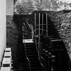 outside the wall (Tristan Styles) Tags: uk light shadow england urban bw abstract southwest tree nature wall bristol blackwhite nikon unitedkingdom pipe steps scafolding airconditioning pcnikkor28mmf35 d7000 copyright2013tristanstylesallrightsreserved