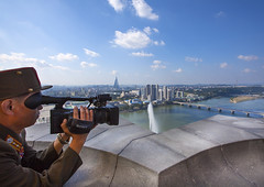 Soldier Filming Pyongyang City From The Juche Tower, Pyongyang, North Korea (Eric Lafforgue) Tags: city bridge sky horizontal architecture river movie soldier army outdoors photography war asia day cityscape sony horizon citylife korea videocamera asie coree connection scenics northkorea pyongyang tranquilscene dprk coreadelnorte capitalcities traveldestinations colorimage highangleshot nordkorea buildingexterior highangleview    img7360 coreadelnord  taedongriver  insidenorthkorea  rpdc  coreiadonorte