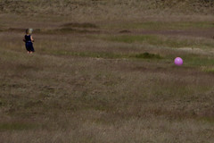 blowing in the wind (IcarusBlue) Tags: pink girl balloon windswept
