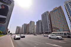 Always sunny (jakobplaschke) Tags: abu dhabi united arab emirates emirate city metropolis buildings building skyscrapers cars road street urban busy sun sunny day middle east travel adventure