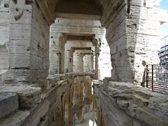 Arles Amphitheatre (AmyEAnderson) Tags: historic outdoor coliseum stadium amphitheatre limestone roman romanesque arches archways collonade shadows stonework architecture arles france bouchesdurhone provence structure unesco