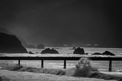 High Surf Advisory - Pacifica Pier (hjl) Tags: ocean sky people bw white black water silhouette clouds landscape pier rocks day waves cloudy pacificocean seal headlands pacifica sanpedrorock manorbeach