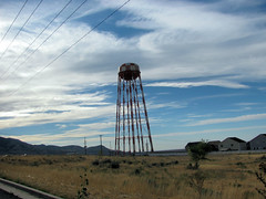 Old Water Tower (Eyellgeteven) Tags: old blue red sky cloud white green tower water clouds big high rust tank cloudy steel watertower rusty rusted tall checkered redandwhite eyellgeteven