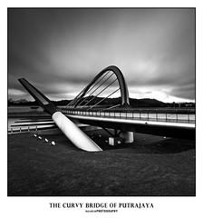 The Curvy Bridge (mozakim) Tags: longexposure bridge sky blackandwhite bw cloud sunrise dam curvy slowshutter putrajaya d300s