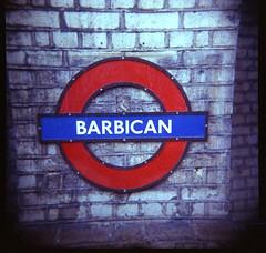 Barbican (Andrew Bartram (WarboysSnapper)) Tags: london 120 sign lomography toycamera barbican plastic londonunderground rollfilm plasticlens c41 holga120fn epsonv500 lomography100film warboyssnapper andrewbartram digibasechemistry
