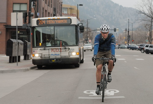Photo - Biker in front of Bus Downtown