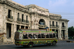 Public bus passing by a decayed colonial building in the former British residential district of Lahore, Punjab, Pakistan (Fugamundi) Tags: pakistan color colour building bus public horizontal architecture transport colonial transportation punjab lahore britishindia britishraj
