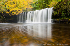 Upper Sgwd Ddwlli Falls (LongLensPhotography.co.uk - Daugirdas Tomas Racys) Tags: longexposure autumn trees orange cliff brown white mountain color green fall nature water leaves yellow wales river flow golden waterfall nationalpark october rocks colours walk low wide trails hike falls breconbeacons fluid upper valley translucent swirl welsh transpare