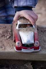 The dirty car (DavidAndersson) Tags: car playground toy kid sand hand sweden vincent vnersborg tamron18200f3563