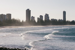Beachside (Konrad Kasperski) Tags: beach australia goldcoast buildings water ocean waves surfer surf foam blue