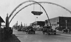 Pacific Coast Highway at Main St., Huntington Beach, circa 1938 (Orange County Archives) Tags: orangecountyarchives orangecounty orangecountyhistory history historical california southerncalifornia huntingtonbeach pacificcoasthighway pch downtown mainstreet arches