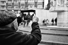 De Dam, Amsterdam (Fokko Muller) Tags: street urban blackandwhite bw man amsterdam europe thenetherlands streetphotography urbanphotography lumix20mmf17 dmcgx1 panasonicgx1