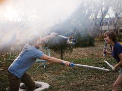 LARP practice (BurlapZack) Tags: fight backyard prism lightleak sword axe nerf spar magichour larp sparring bendinglight sundayfunday dentontx siblingrivalry panasonicleicadgsummilux25mmf14 vscofilm olympusomdem5