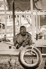 When you're going through hard times, just keep smiling cause you'll make it through! (Cohibathebest cigar in the world) Tags: africa sepia zeiss boat interesting african sony egypt smoking full frame strong emotional alpha afrikaans a850 dramactic snoekx sonnart18135 cohibathebest
